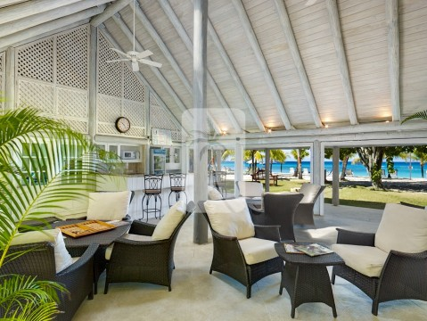 The Sandy Lane beach facility bar and seating area overlooking the powdery sand and aquamarine water