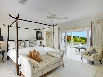 The Master bedroom suite spans the entire top floor of and includes east and west facing terraces