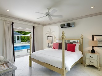 Poolside en suite guest bedroom with a King sized bed, air conditioning and quality linen