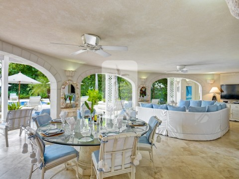 Al fresco dining under the covered terrace overlooking the swimming pool