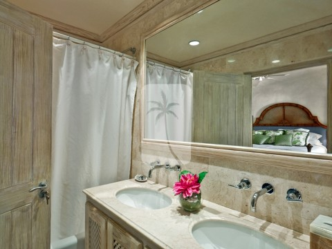 One of the luxurious en suite bathrooms. The bathrooms afford marble tiles with rain showers