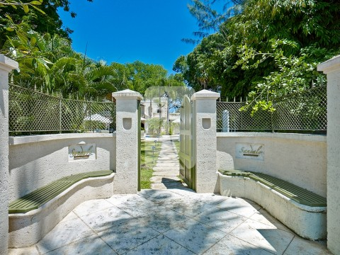This private beach gate leads to the beautiful white sands and crystal waters of Gibbs Bay